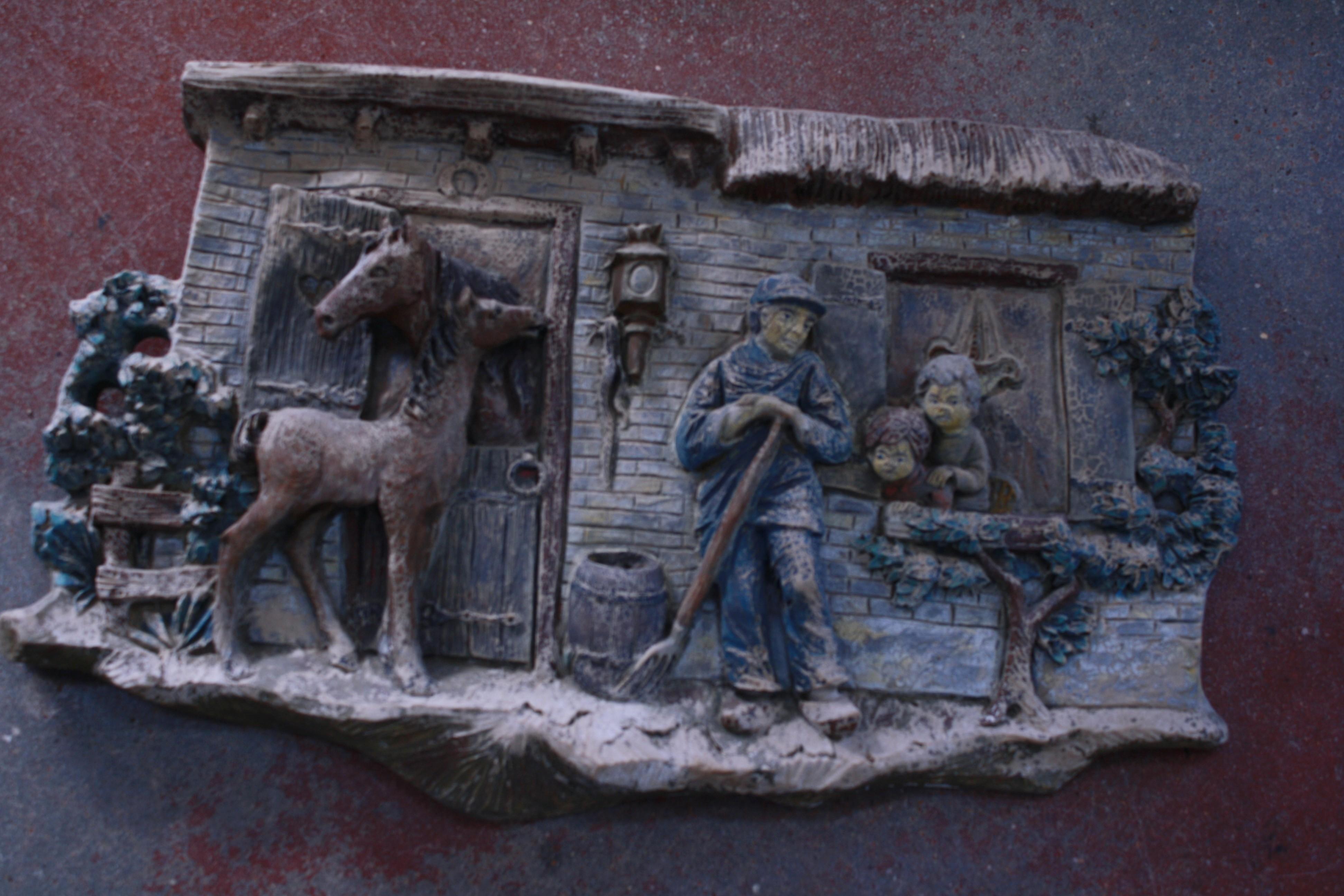 Concrete garden relief