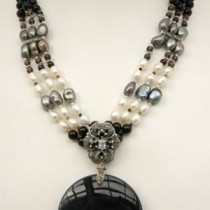 Necklace of three strands of onyx, fresh water pearls and sterling silver beads with marcasite bars, and a drop of marcasite and large onyx disk
