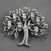 Owls in a tree brooch