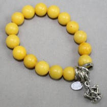 Yellow gemstone bracelet with crown